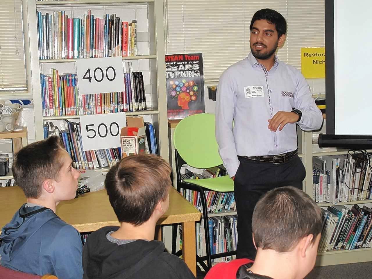 Jaspreet Rehal, a 2005 graduate of Crone Middle School in Naperville and a nuclear engineer at Exelon, speaks with eighth-graders at his alma mater, explaining the clean energy characteristics of nuclear power.
