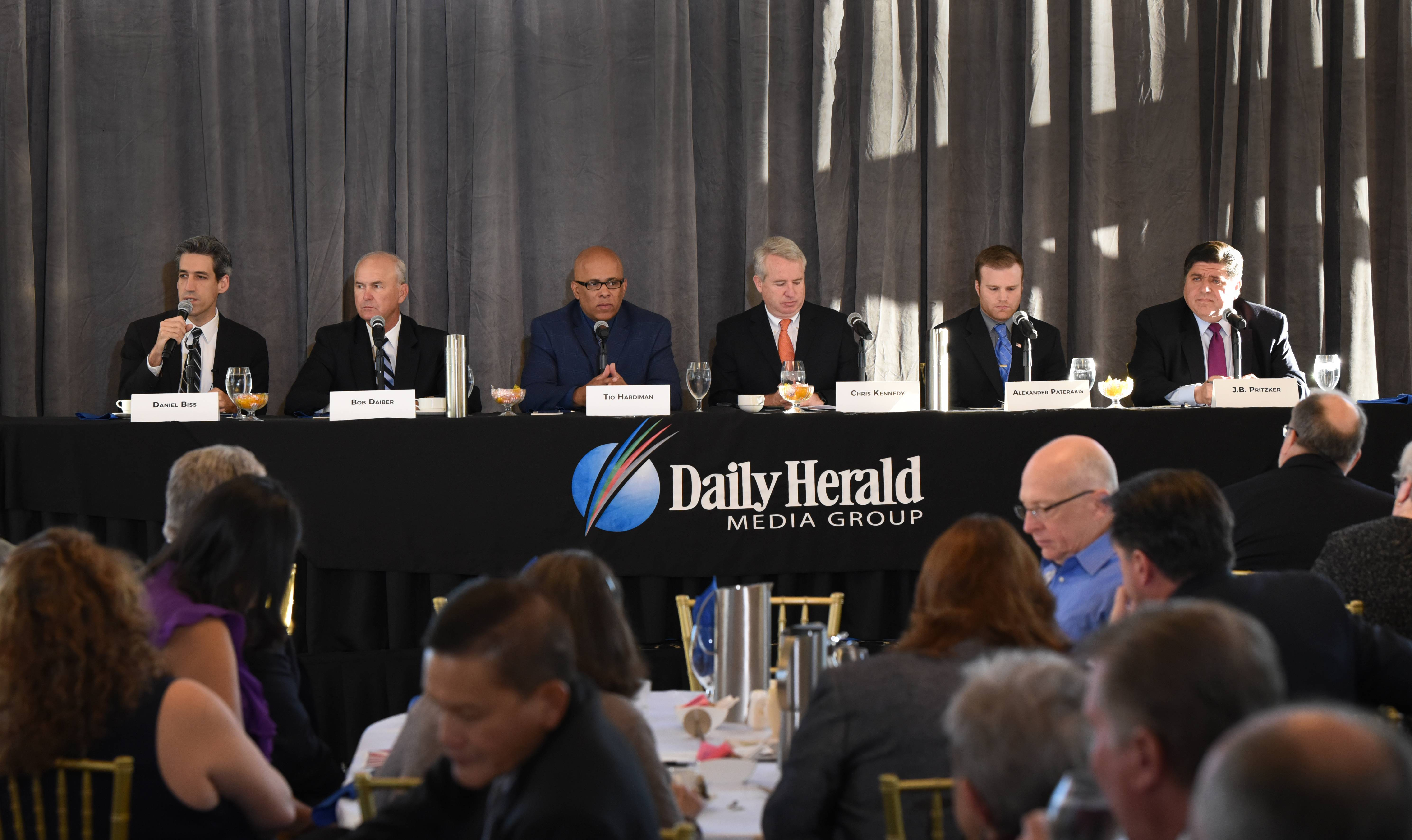Democratic gubernatorial candidates, left to right, Daniel Biss, Bob Daiber, Tio Hardiman, Chris Kennedy, Alexander Paterakis and J.B. Pritzker answer questions about their candidacy Wednesday morning in Mount Prospect.