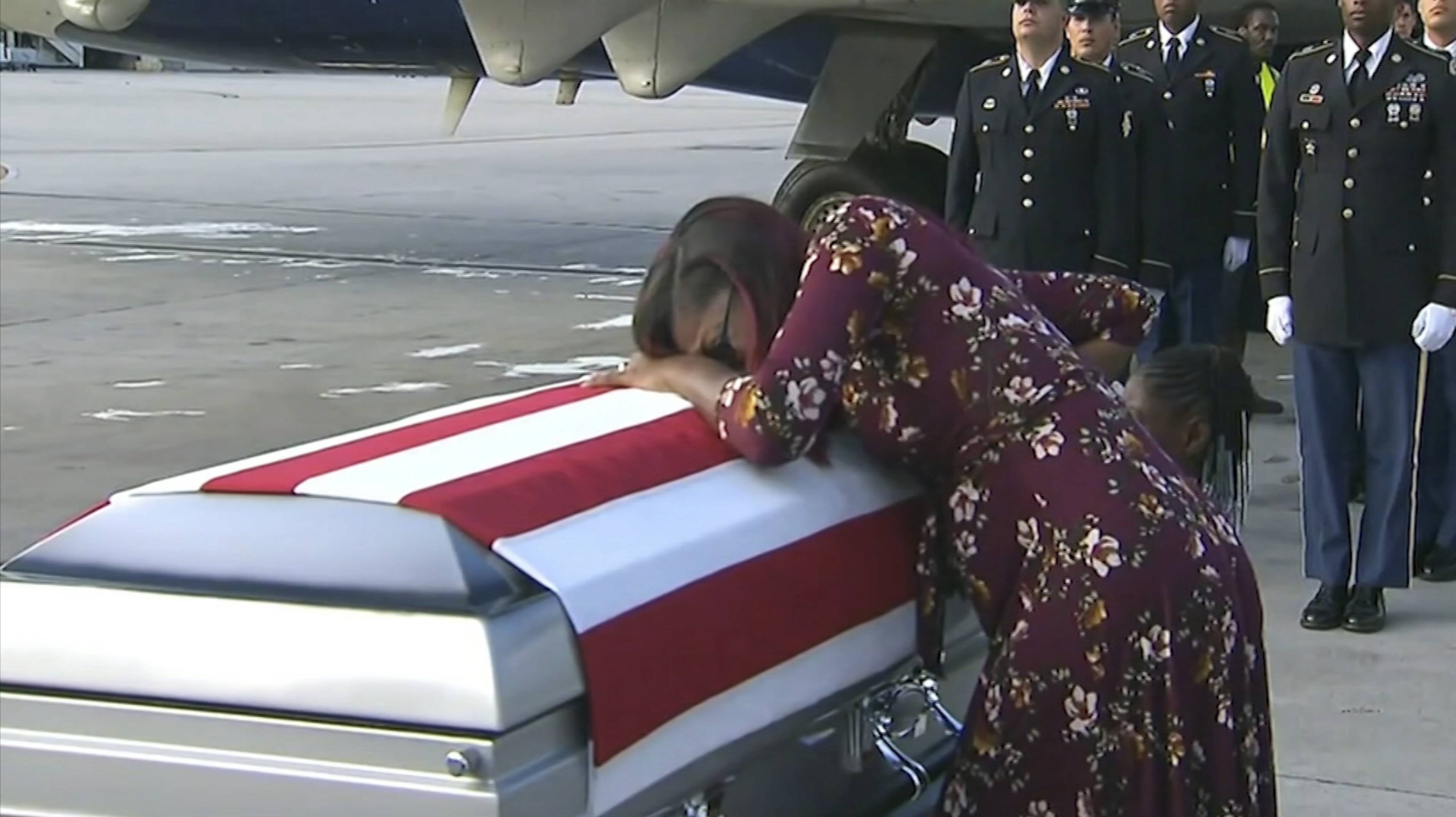 "In this Tuesday, Oct. 17, 2017, frame from video, Myeshia Johnson cries over the casket in Miami of her husband, Sgt. La David Johnson, who was killed in an ambush in Niger. President Donald Trump told the widow that her husband ""knew what he signed up for,"" according to Rep. Frederica Wilson who said she heard part of the conversation on speakerphone."
