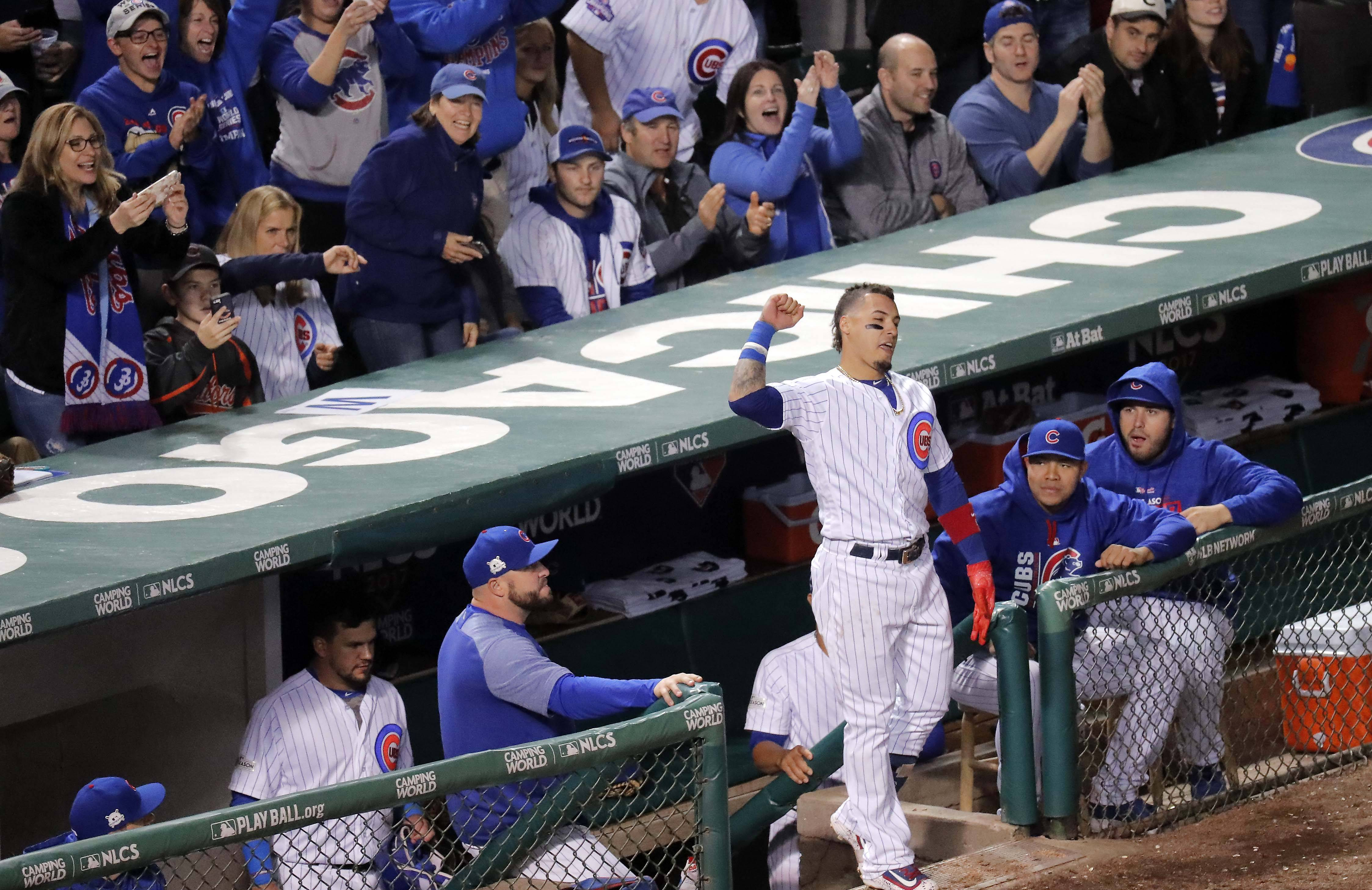 Chicago Cubs second baseman Javier Baez (9) comes out for a curtain call after his home run in the 5th inning during Game 4 of the National League championship series, Oct, 18 2017, at Wrigley Field in Chicago.