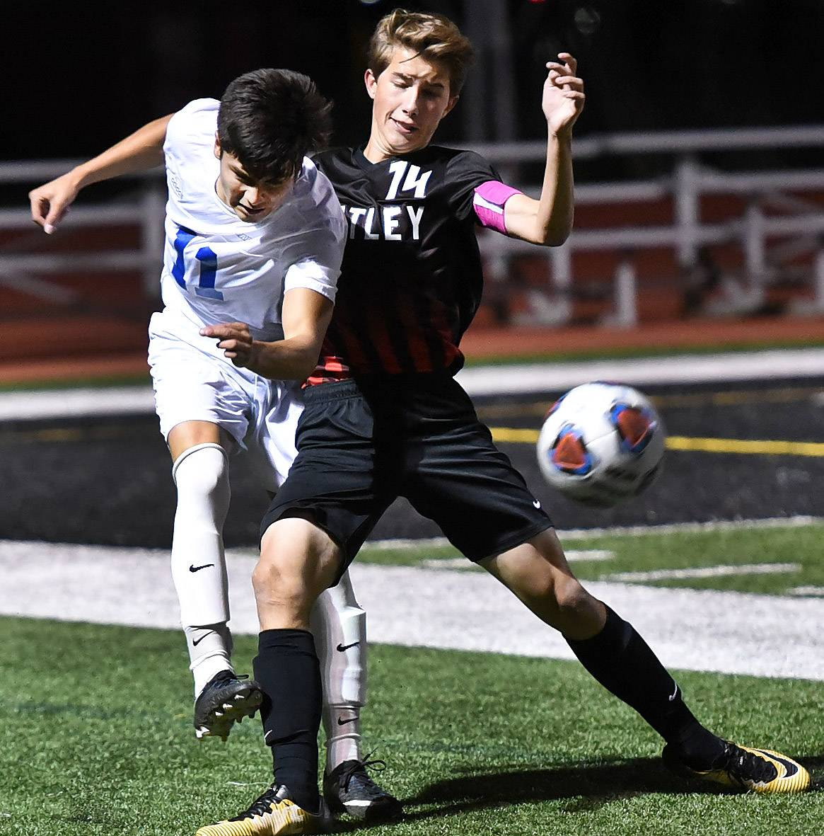 Larkin's Sergio Cruz battles for the ball with Huntley's Drew Landoch during Larkin at Huntley regional soccer.