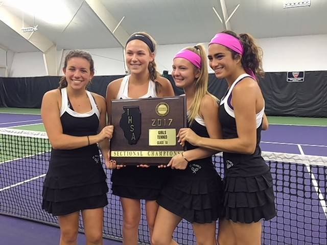 On Oct. 14 at the Class 1A Joliet Catholic sectional, St. Francis won its first girls tennis sectional in school history. Enjoying the moment are state qualifiers (from left) Gina Vale, Jane Price, Marnie Kopec and Alyssa Gulli.