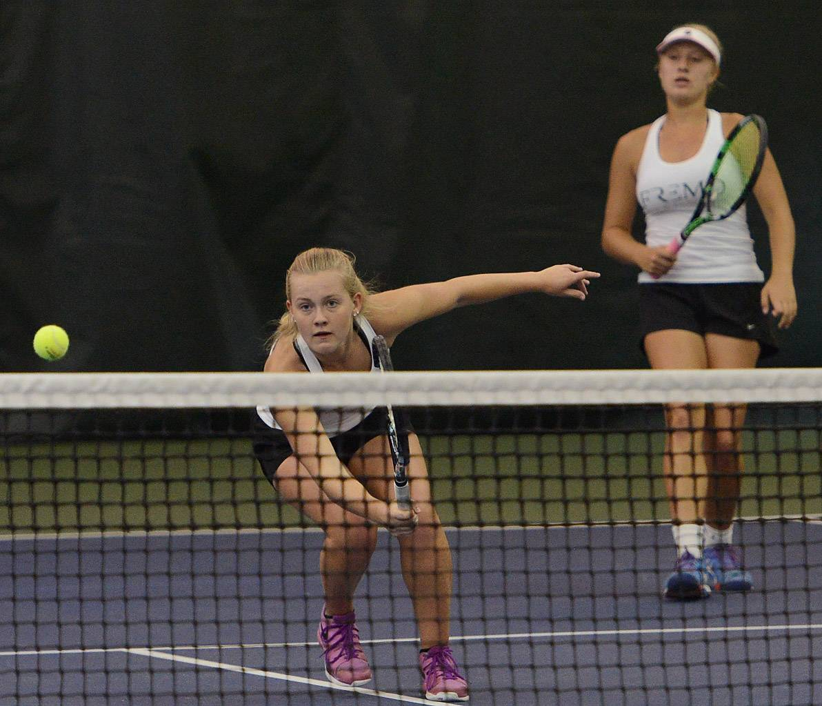 Fremd senior doubles standouts Julia Smiarowska, left, and Kate Bodensteiner, on their way to a Hersey sectional title on Saturday in Arlington Heights.