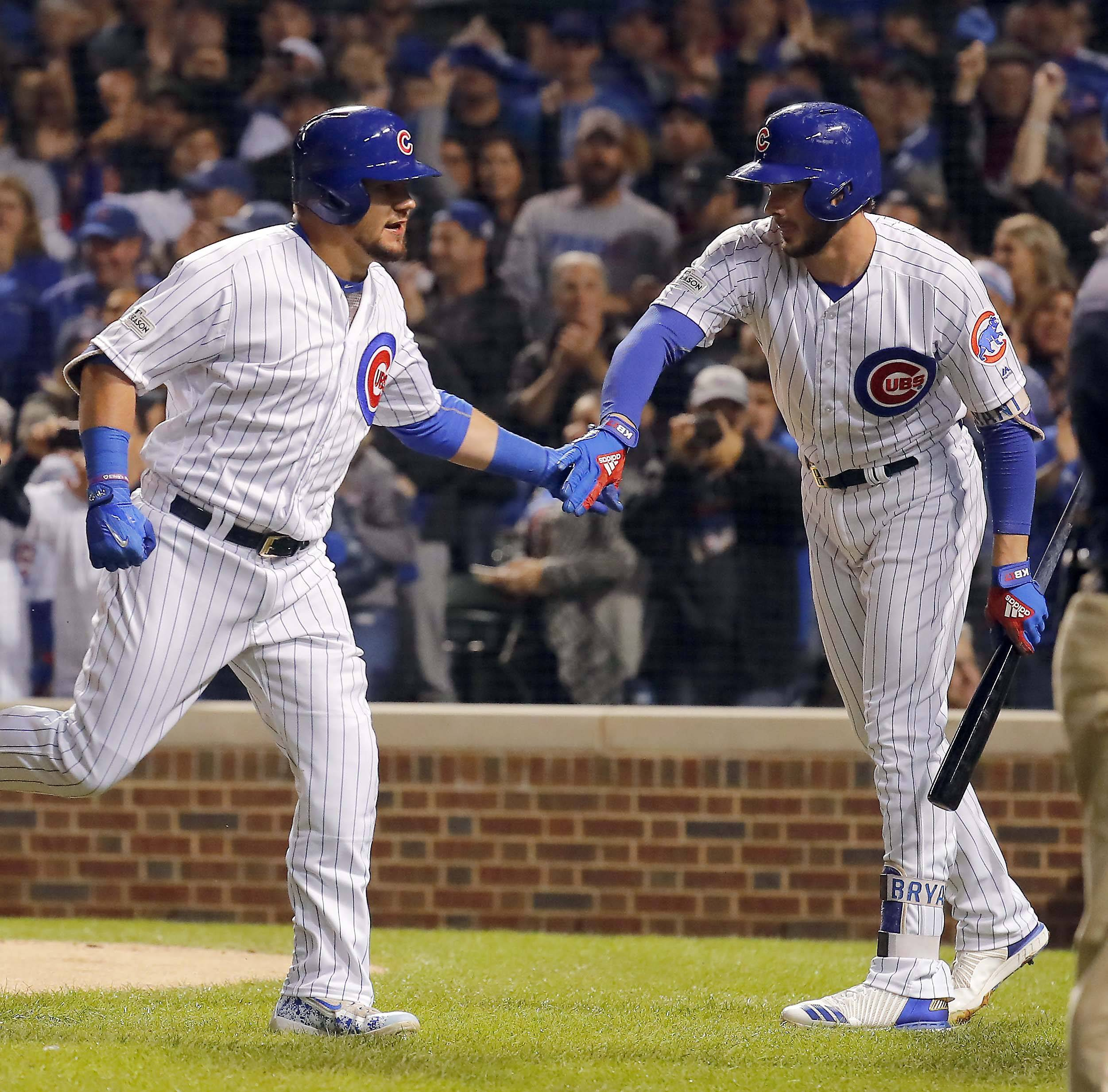 Chicago Cubs left fielder Kyle Schwarber (12) is greeted by Kris Bryant (17) after his first inning home run during Game 3 of the National League championship series. Schwarber will also start in Game 4.