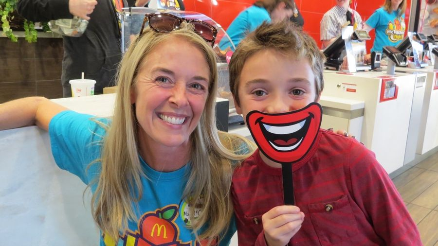 Sherwood Elementary School Special Education teacher Jennifer Ciral is smiling wide with third-grader Spencer Schachter at the McTeacher's Night held on October 17th at the Bannockburn McDonald's located on Waukegan Road.Julie Travers