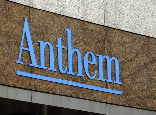 FILE - This Dec. 3, 2014, file photo, shows the Anthem logo at the company's corporate headquarters in Indianapolis. Anthem has found a new partner to help run prescription drug coverage after the Blue Cross-Blue Shield insurer's rocky relationship with Express Scripts ends. The nation's second-largest insurer says it will create a pharmacy benefits manager called IngenioRx starting in 2020 and will work with CVS Health Corp. to manage the business. (AP Photo/Darron Cummings, File)