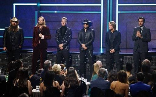 (l to r) Chris Stapelton, Brian Kelly, Tyler Hubbard, Jason Aldean, Keith Urban and Luke Bryan are seen at 2017 CMT Artist of the Year Awards at Nashville's Schermerhorn Symphony Center on Wednesday, Oct. 18, 2017, in Nashville, Tenn. (Photo by Wade Payne/Invision/AP)
