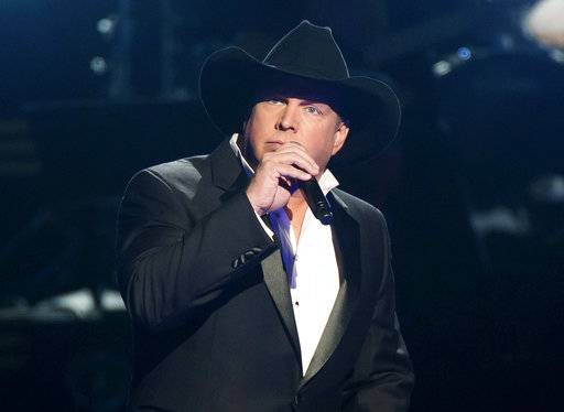 FILE - In this Nov. 2, 2016 file photo, Garth Brooks performs at the 50th annual CMA Awards in Nashville, Tenn. Brooks, along with Brothers Osborne, Luke Bryan, Eric Church, Alan Jackson, Miranda Lambert, Little Big Town, Old Dominion, Jon Pardi, Chris Stapleton, Thomas Rhett and Carrie Underwood will all perform at this years Country Music Association awards on Nov. 8. (Photo by Charles Sykes/Invision/AP, File)