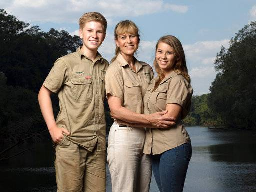 "This image released by Animal Planet shows the Irwin family, from left, Robert, Terri and Bindi. The Irwin family is returning to television's Animal Planet, 11 years after the death of ""The Crocodile Hunter"" star and family patriarch Steve Irwin. The network announced Wednesday that they will work with Animal Planet on television and digital projects that will begin being seen next year. ("
