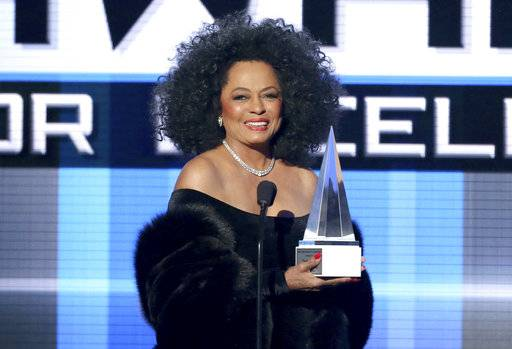 FILE - In this Nov. 23, 2014, file photo, Diana Ross presents the Dick Clark award for excellence at the 42nd annual American Music Awards. ABC and Dick Clark Productions announced on Oct. 18, 2017, that Ross would receive a lifetime achievement honor and perform at the upcoming ceremony on Nov. 19. (Photo by Matt Sayles/Invision/AP, File)