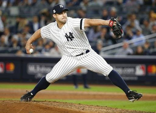 New York Yankees relief pitcher Tommy Kahnle throws during the eighth inning of Game 5 of baseball's American League Championship Series against the Houston Astros Wednesday, Oct. 18, 2017, in New York. (AP Photo/Kathy Willens)