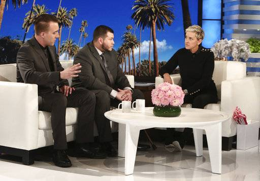 "In this Oct. 17, 2017, photo released by Warner Bros., Stephen Schuck, left, and Jesus Campos appear with host Ellen Degeneres during a taping of ""The Ellen DeGeneres Show"" at the Warner Bros. lot in Burbank, Calif. Schuck, a building engineer, and Campos, a security guard, were working at the Mandalay Bay Resort and Casino the night of the mass shooting on Oct. 1. Campos was shot by gunman Stephen Paddock. The show airs on Wednesday. (Photo by Michael Rozman/Warner Bros.)"
