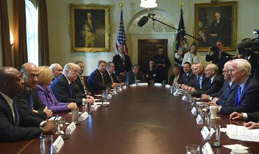 President Donald Trump, center left, meets with members of the Senate Finance Committee and members of the President's economic team in the Cabinet Room of the White House in Washington, Wednesday, Oct. 18, 2017. (AP Photo/Susan Walsh)