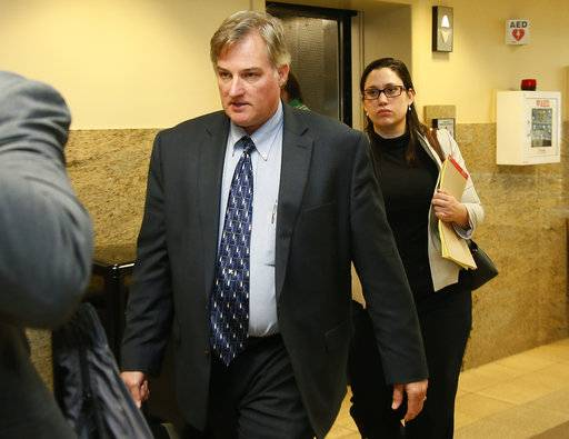 FILE - In this June 30, 2017 file photo, ex-Tulsa police officer Shannon Kepler, left, arrives with his legal team for afternoon testimony in his third trial in Tulsa, Okla. Jurors in the fourth murder trial for Kepler, a white former Oklahoma police officer, heard a 911 call Tuesday, Oct. 17, 2017 where his daughter screams to dispatchers that her father had shot her 19-year-old black boyfriend. (AP Photo/Sue Ogrocki, File)