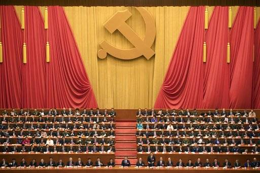 "Chinese President Xi Jinping, center, presides over the opening ceremony of the 19th Party Congress held at the Great Hall of the People in Beijing Wednesday, Oct. 18, 2017. Xi on Wednesday urged a reinvigorated Communist Party to take on a more forceful role in society and economic development to better address ""grim"" challenges facing the country as he opened a twice-a-decade national congress. (AP Photo/Ng Han Guan)"