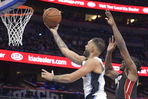 Orlando Magic guard Evan Fournier, left, goes up for a shot in front of Miami Heat guard Josh Richardson during the second half of an NBA basketball game Wednesday, Oct. 18, 2017, in Orlando, Fla. The Magic won 116-109. (AP Photo/Phelan M. Ebenhack)