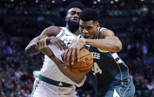 Milwaukee Bucks forward Giannis Antetokounmpo, right, tries to drive past Boston Celtics forward Jaylen Brown, left, during the first quarter of an NBA basketball game, Wednesday, Oct. 18, 2017, in Boston. (AP Photo/Charles Krupa)
