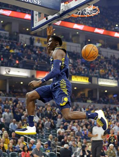 Indiana Pacers guard Victor Oladipo (4) follows through on a dunk against the Brooklyn Nets during the first half of an NBA basketball game in Indianapolis, Wednesday, Oct. 18, 2017. (AP Photo/Michael Conroy)