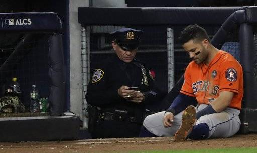 Houston Astros' Jose Altuve sits near the dugout during the ninth inning of Game 5 of baseball's American League Championship Series against the New York Yankees Wednesday, Oct. 18, 2017, in New York. (AP Photo/David J. Phillip)