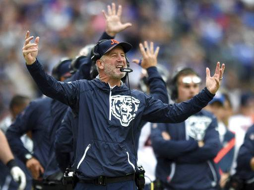 FILE - In this Sunday, Oct. 15, 2017, file photo, Chicago Bears head coach John Fox reacts in the first half of an NFL football game against the Baltimore Ravens in Baltimore. Fox has the Bears playing it safe, with few pass attempts and as many runs as possible. (AP Photo/Gail Burton, File)