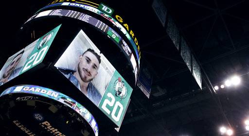 Boston Celtics forward Gordon Hayward is introduced to the crowd on the scoreboard from his hospital bed prior to the first quarter of an NBA basketball game against the Milwaukee Bucks, Wednesday, Oct. 18, 2017, in Boston. Hayward was injured in the season opener on Tuesday against the Cleveland Cavaliers. (AP Photo/Charles Krupa)