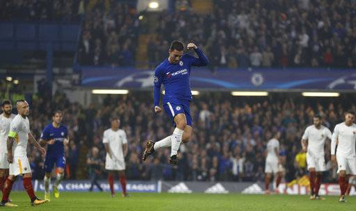 Chelsea's Eden Hazard celebrates after scoring during the Champions League group C soccer match between Chelsea and Roma at Stamford Bridge stadium in London, Wednesday, Oct. 18, 2017. (AP Photo/Kirsty Wigglesworth)