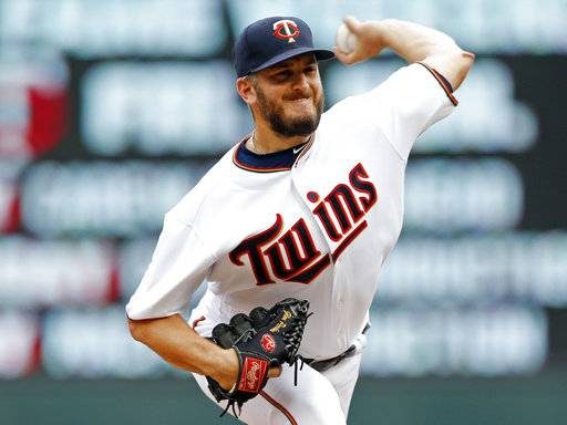 FILE - In this Thursday, Aug. 17, 2017 file photo, Minnesota Twins pitcher Glen Perkins throws against the Cleveland Indians during the ninth inning in the first baseball game of a doubleheader in Minneapolis. The Minnesota Twins have informed reliever Glen Perkins they will decline their $6.5 million option on his contract for 2018 and pay him a $700,000 buyout. The Twins announced the decision Wednesday, Oct. 18, 2017 moving Perkins closer to retirement. (AP Photo/Jim Mone, File)