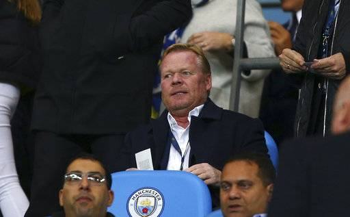 Everton coach Ronald Koeman waits the start of the Champions League group F soccer match between Manchester City and Napoli at the Etihad Stadium in Manchester, England, Tuesday, Oct.17, 2017. (AP Photo/Dave Thompson)