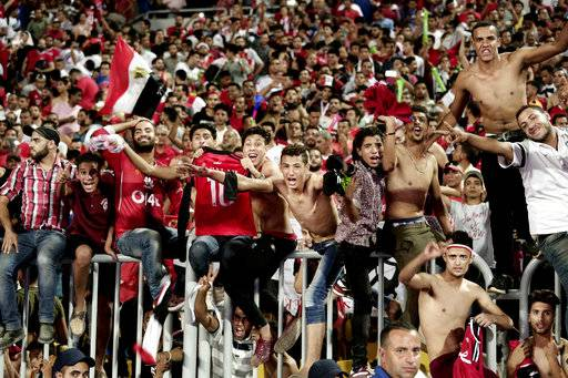 "FILE - In this Sunday, Oct. 8, 2017 file photo, Egyptian fans celebrate after their win over Congo during the 2018 World Cup group E qualifying soccer match in Alexandria, Egypt. ""Youm7,� or Seventh Day, a Cairo daily, said in an article in the newspaper's online edition Wednesday, Oct. 18, 2017, that Egypt's qualification at next year's World Cup has made many male fans dream about traveling to Russia to meet local women and is warning them they should lower their expectations about meeting Russian women. (AP Photo/Nariman El-Mofty, File)"