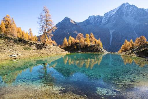 Lake Lac Bleu is pictured during a beautiful autumn day, near Arolla, in Valais, Switzerland, this Wednesday, Oct. 18, 2017. (Anthony Anex/Keystone via AP)