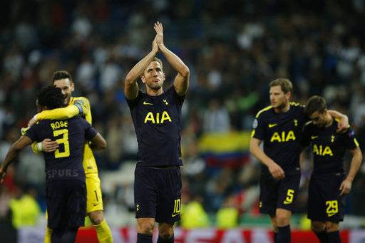 Tottenham's Harry Kane applauds to fans at the end of a Group H Champions League soccer match between Real Madrid and Tottenham Hotspur at the Santiago Bernabeu stadium in Madrid, Tuesday Oct. 17, 2017. (AP Photo/Paul White)