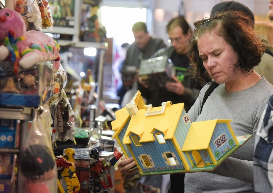 Susanna Vitale of St. Charles looks over a Fisher Price Family Play House during the 43rd Chicago Toy Show at the Kane County Fairgrounds.