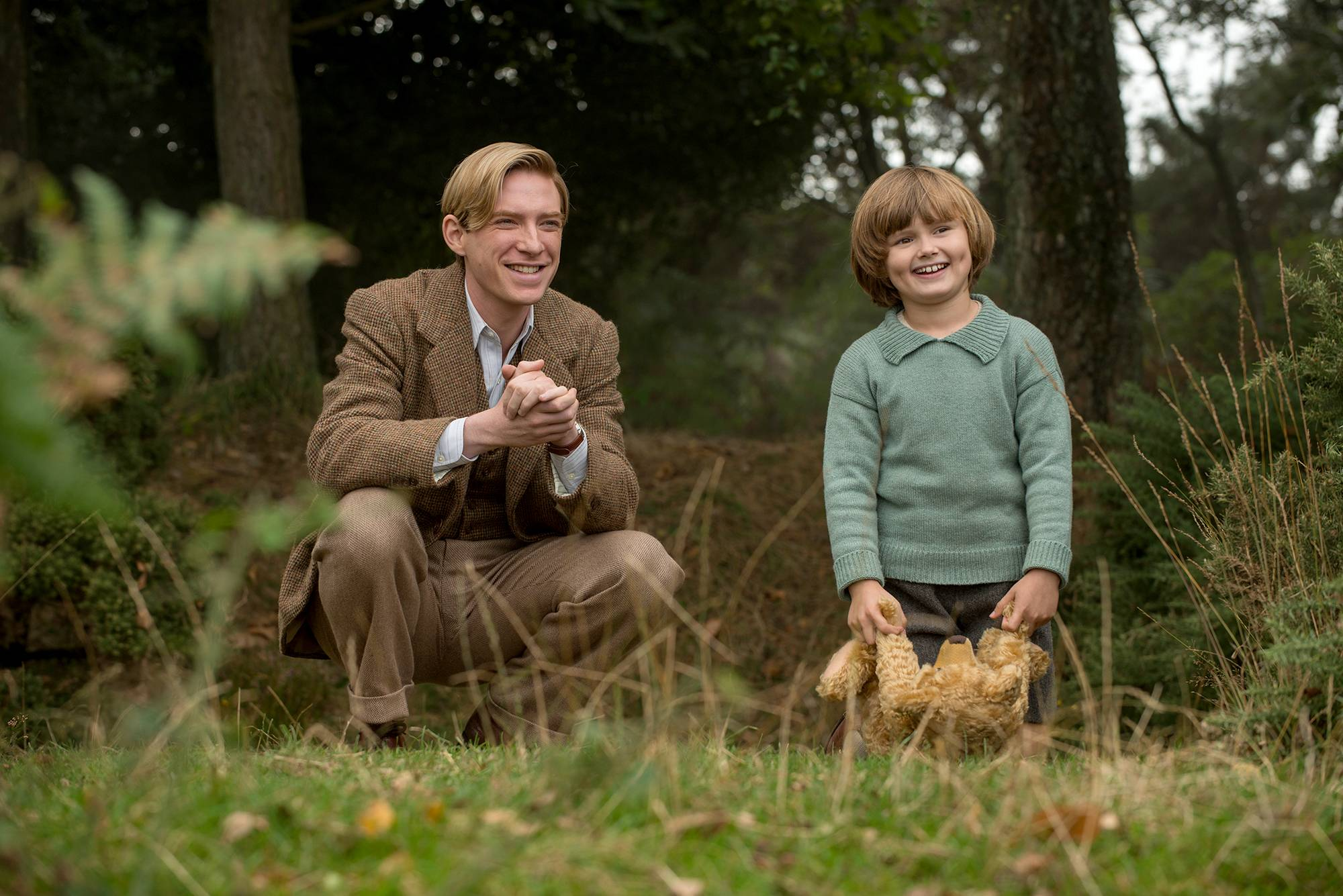 """Winnie-the-Pooh"" author A.A. Milne (Domhnall Gleeson) bases his best-sellers on the ideas of his own son (Will Tilston) in the biopic ""Goodbye Christopher Robin."""