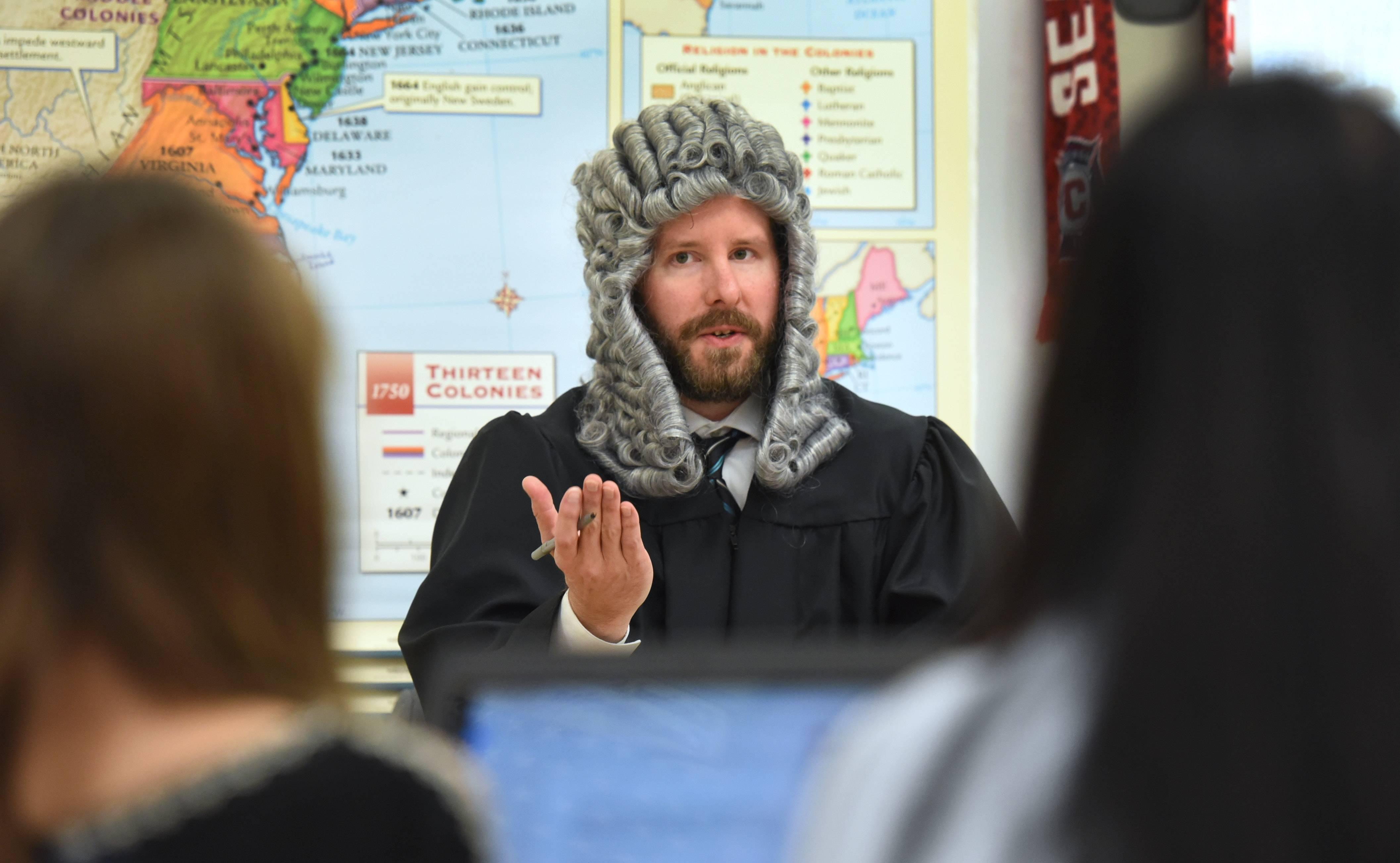 Social studies teacher Matt Lakemacher plays a judge during a Boston Massacre mock trial he conducted Thursday with his seventh-grade students at Woodland Middle School in Gurnee.