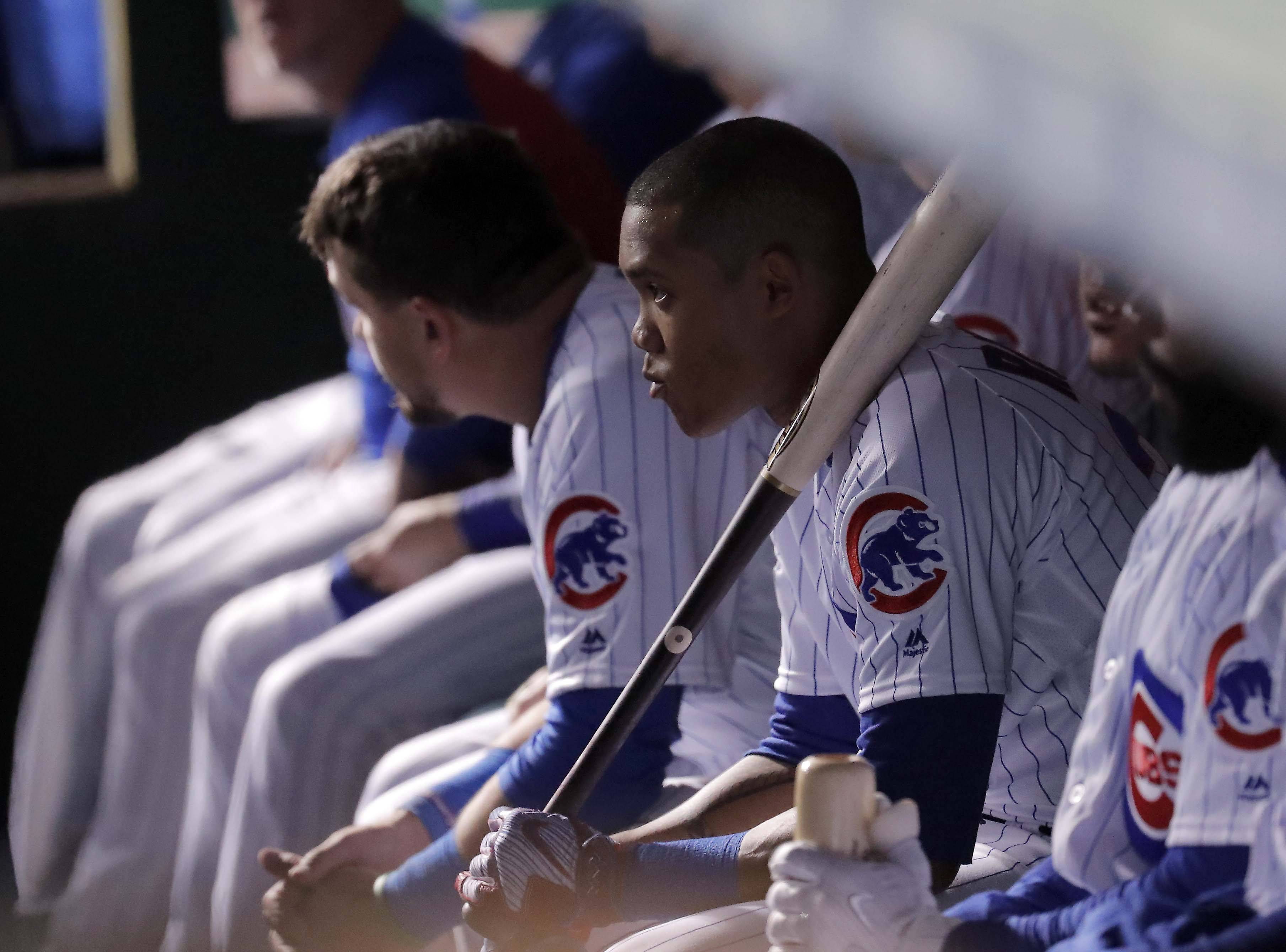 Chicago Cubs shortstop Addison Russell looks dejected in the dugout as Game 5 of the National League Championship Series Thursday at Wrigley Field in Chicago comes to an end.