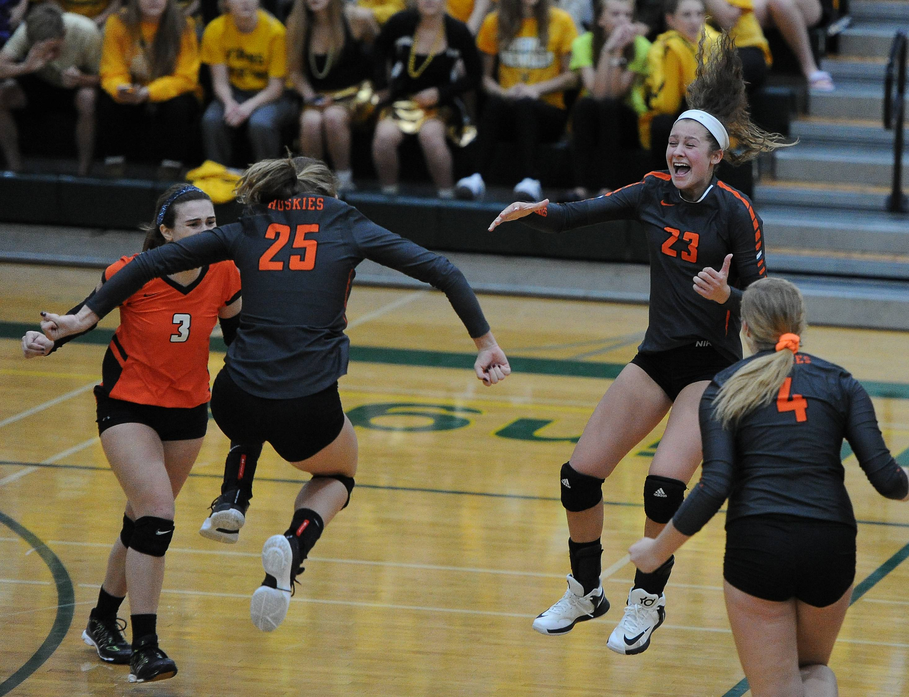 Hersey's Kati Kaburov and Alessia Olhava seem to defy gravity as the Huskies claim the Mid-Suburban League championship in two sets Thursday at Fremd.