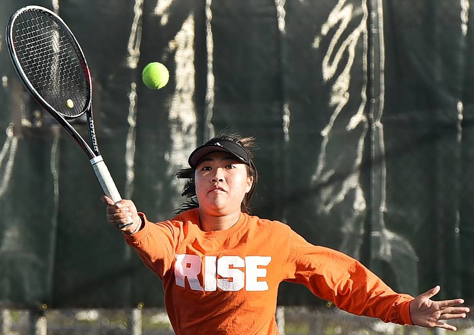 Wheaton Warrenville South's Samantha Choi defeating Palatine's Kanae Kawai during first round action of girls state tennis tournament matches at Palatine High School.