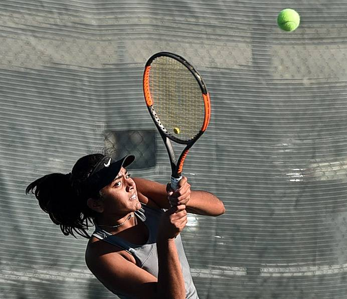 Stevenson's Athena Kolli playing Von Steuben's Steffi Lao during first-round action of the girls tennis state tournament on Thursday at Palatine High School.