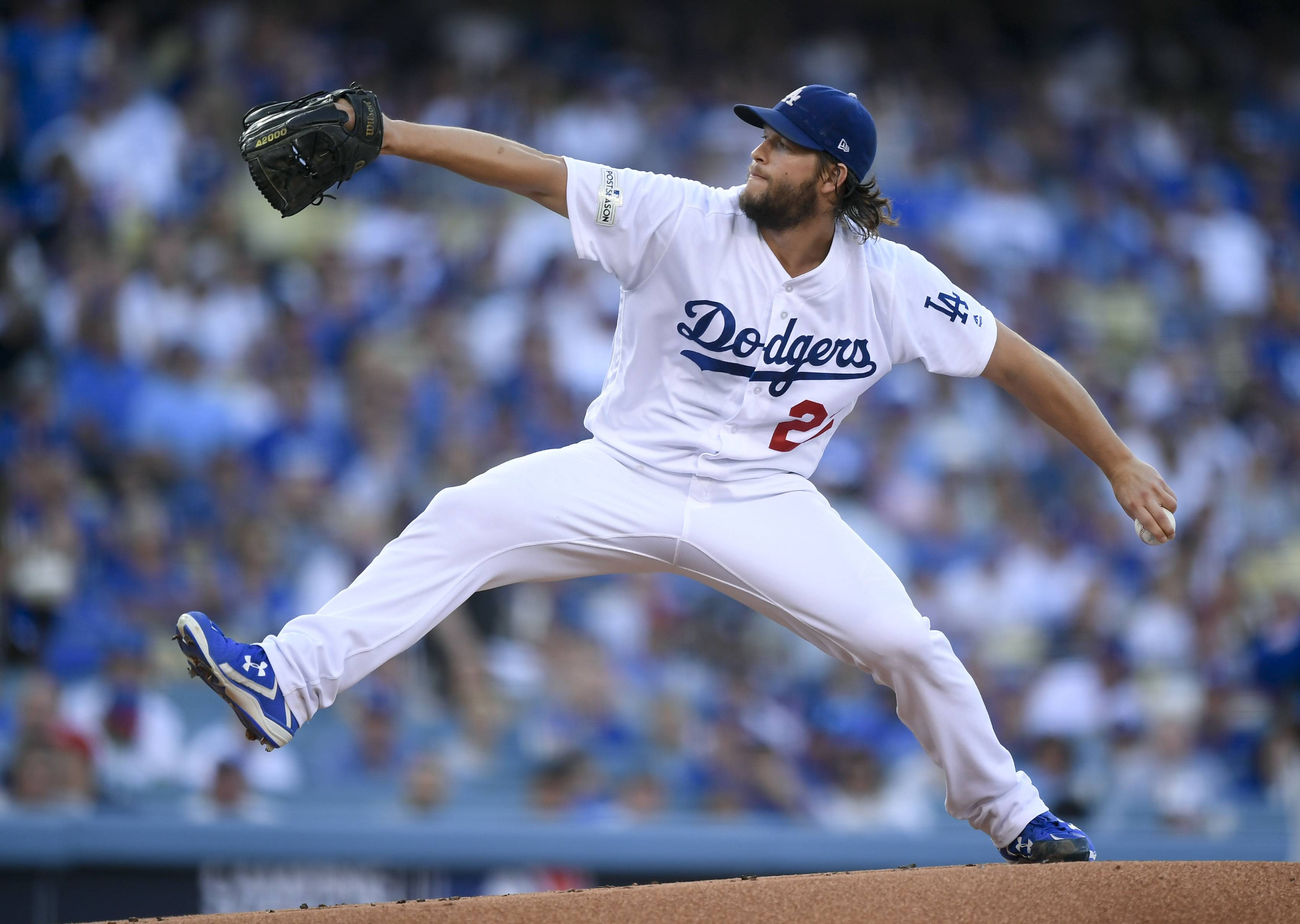 Los Angeles Dodgers starting pitcher Clayton Kershaw throws against the Chicago Cubs during the first inning of Game 1 of the NLCS in Los Angeles.