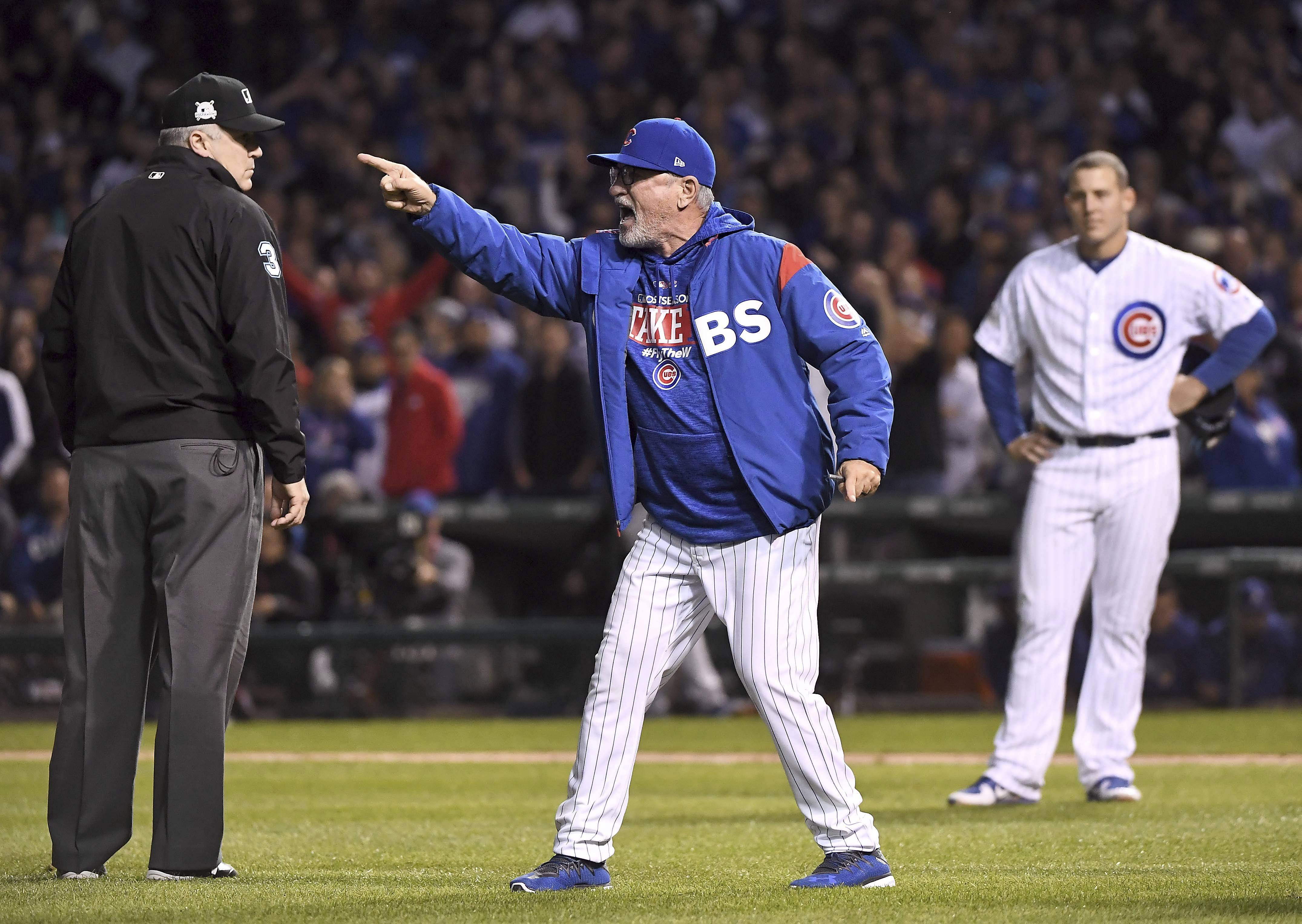 Chicago Cubs manager Joe Maddon argues a call during the eighth inning in Game 4 of the NLCS at Wrigley Field.