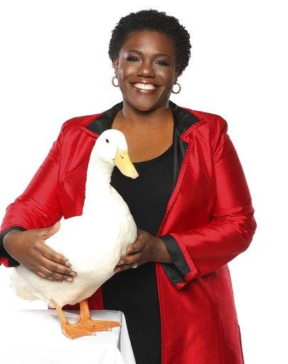 In this Dec. 28, 2015 photo released by Aflac U.S., President of Georgia-based insurance giant Aflac U.S. Teresa White poses for a photo in Georgia. White, the first black president of Georgia-based insurance giant Aflac U.S., is on a quest to help young African-American girls succeed. (Lonnie Major/Aflac U.S., via AP)