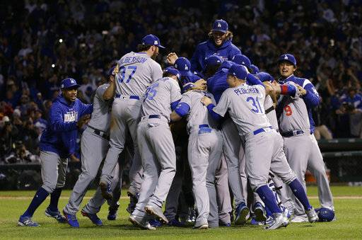 The Los Angeles Dodgers players celebrate after Game 5 of baseball's National League Championship Series against the Chicago Cubs, Thursday, Oct. 19, 2017, in Chicago. The Dodgers won 11-1 to win the series and advance to the World Series. (AP Photo/Nam Y. Huh)