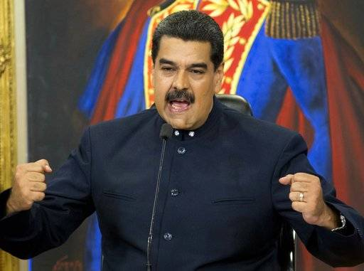 Venezuela's President Nicolas Maduro speaks during a press conference at the Miraflores presidential palace, in Caracas, Venezuela, Tuesday, Oct. 17, 2017. Maduro defended the results of Sunday's gubernatorial elections and said that those who report fraud are lying. (AP Photo/Ariana Cubillos)