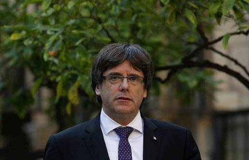 Catalan President Carles Puigdemont arrives for a meeting at the Palau Generalitat in Barcelona, Spain, Tuesday, Oct. 17, 2017. Spain's confrontation with its independence-seeking region of Catalonia intensified Monday when a judge ordered the leaders of two pro-independence groups jailed while they are investigated on possible sedition charges for organizing demonstrations before the region's disputed secession vote.