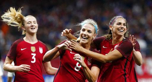 U. S. midfielder Julie Ertz (8) celebrates her goal with teammates Samantha Mewis (3) and Alex Morgan, right, during the first half of an international friendly women's soccer match against South Korea in New Orleans, Thursday, Oct. 19, 2017. (AP Photo/Gerald Herbert)