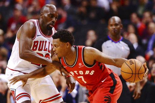Toronto Raptors guard Kyle Lowry (7) drives against Chicago Bulls guard Quincy Pondexter (20) during the second half of an NBA basketball game Thursday, Oct. 19, 2017, in Toronto. (Frank Gunn/The Canadian Press via AP)