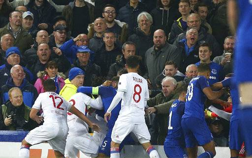 Everton, in blue, and Lyon players clash during a Group E Europa League soccer match between Everton F.C. and Olympique Lyon at Goodison Park Stadium, Liverpool, England, Thursday Oct. 19, 2017. (AP Photo/Dave Thompson)