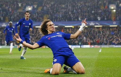 Chelsea's David Luiz celebrates after scoring during the Champions League group C soccer match between Chelsea and Roma at Stamford Bridge stadium in London, Wednesday, Oct. 18, 2017. (AP Photo/Frank Augstein)