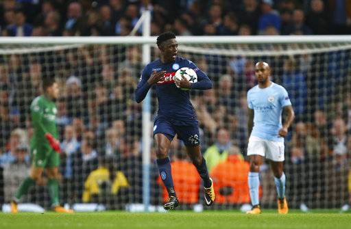Napoli's Amadou Diawara celebrates after scoring during the Champions League group F soccer match between Manchester City and Napoli at the Etihad Stadium in Manchester, England, Tuesday, Oct.17, 2017. (AP Photo/Dave Thompson)