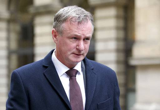 Northern Ireland soccer manager Michael O'Neill leaves in Sheriff Court in Edinburgh, Scotland where he pleaded guilty to drink-driving on Thursday Oct. 19, 2017. O'Neill has pleaded guilty to drink driving and been banned from the road for 16 months. O'Neill was caught by police on the outskirts of Edinburgh at about 1 a.m. on Sept. 10 and was found to be around three times the legal drink-drive limit. Northern Ireland is still in contention for its first World Cup trip since 1986. (Jane Barlow/PA via AP)